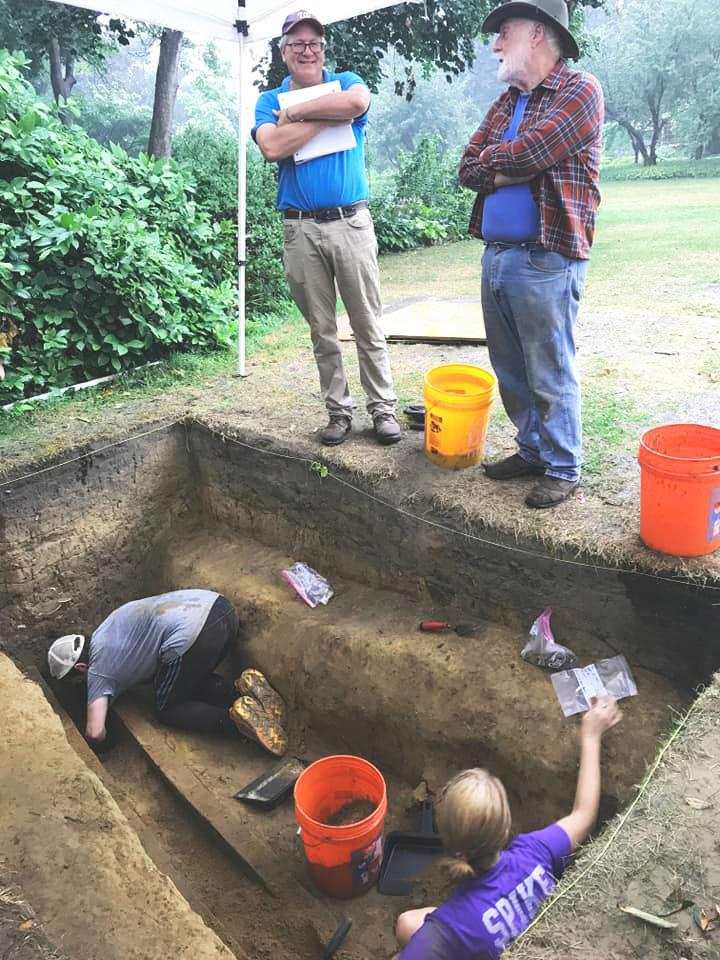 Dr. Michael Lucas, Curator of Historical Archaeology (left) and Marty Pickands, retired museum archaeologist (right) overlooking excavation by SUNY Albany field school students -- photo by Derek J. Healey