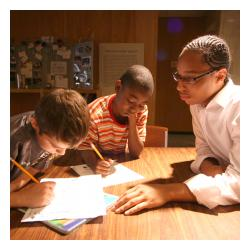 3 boys reading and doing homework