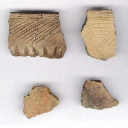 pottery pieces uncovered in archaeological dig