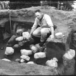 black and white photo man sitting in ground