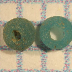 Two blue beads recovered from the outer kitchen excavation at Ten Broeck Mansion