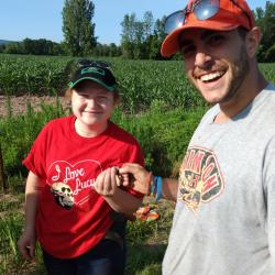 Volunteers Chelsea S. and John G. celebrate their fluted point find at OPS site, July 11, 2019.