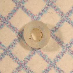 White bead found during excavation of Ten Broeck Mansion's outer kitchen