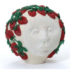 "E2014.24  ""Strawberry Moon"" by Tammy Tarbell-Boehning (Mohawk)   Raised glass beadwork on clay"
