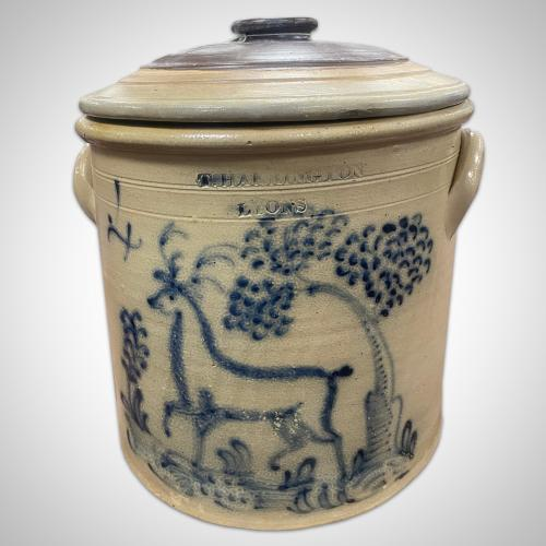 Four gallon crock with cover, T. Harrington, Lyons, NY; decorated with a prancing stag in a wooded landscape, ca. 1860.