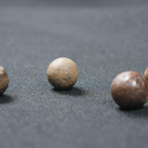 Stoneware and redware marbles, 1600s