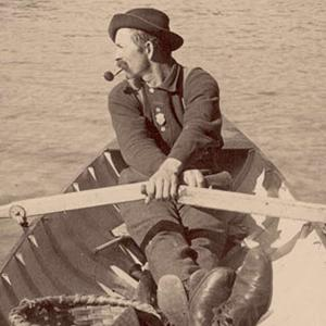 Photo of man in rowboat