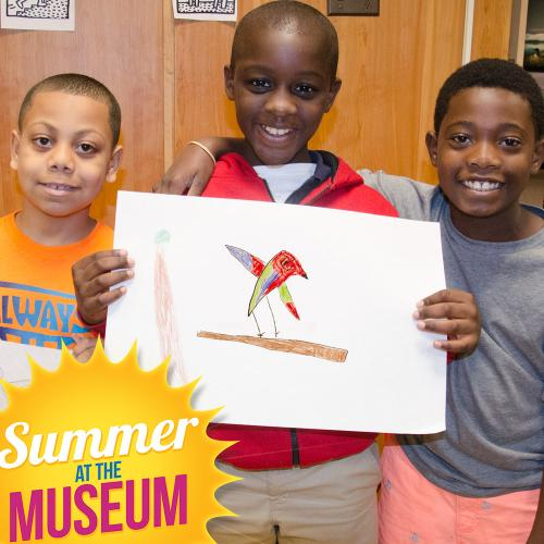 Group of boys with hand drawn picture of red bird