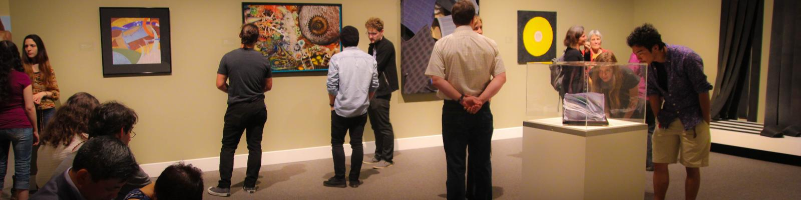 people looking at artwork