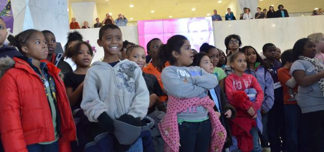 Children gathered in the museum lobby